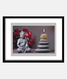 bouddha avec des bougies et des pierres dans le sable