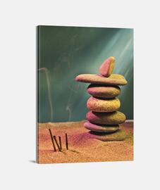 torre di pietre in sabbia e incenso