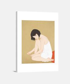 una mujer pintando una pedicura