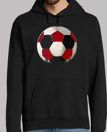ballon à rojiblanco et football noir