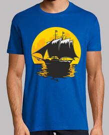 barco de vela bajo la luna