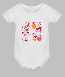 bebé mono corazones