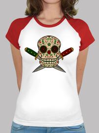 Calavera mexicana con puñales vintage