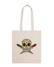 Calavera mexicana y puñales vintage desgastado