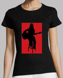 Cantautora tocando guitarra