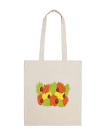 hojas y mariquitas en bolsa de otoño