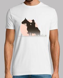 Jinete a caballo con puesta de sol
