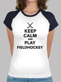 mantener la calma y jugar a hockey hierba