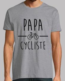Papá ciclista andando en bicicleta