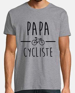 papà in bicicletta in sella a una bicic