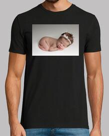 Preciosa bebé en los brazos de Morfeo