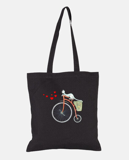 Red vintage bicycle with blue cat