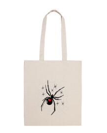 Tela de araña con pequeñas arañas dispe