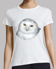 White owl looks with yellow eyes